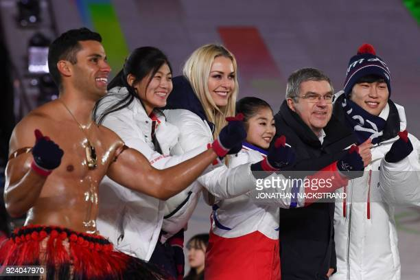 TOPSHOT Tonga's Pita Taufatofua China's Liu Jiayu USA's Lindsey Vonn North Korea's Kim Ju Sik International Olympic Committee president Thomas Bach...