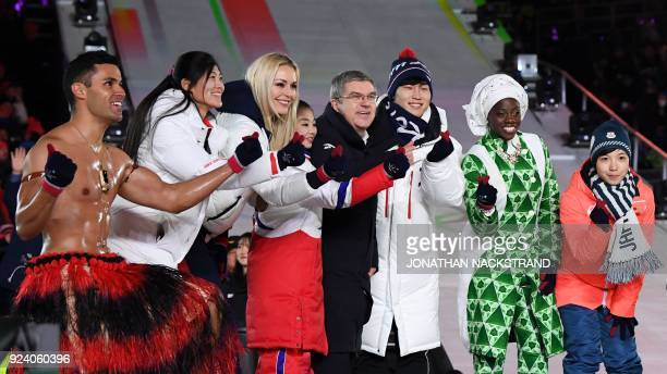 Tonga's Pita Taufatofua China's Liu Jiayu USA's Lindsey Vonn North Korea's Kim Ju Sik International Olympic Committee president Thomas Bach South...
