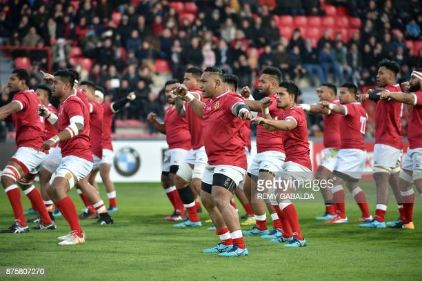 Tonga's players perform a haka prior to the test union international match between Japan and Tonga on November 18 at the Ernest Wallon Stadium in...