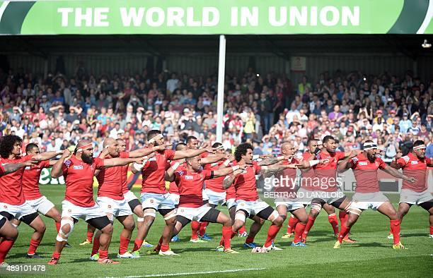 Tonga's players perform their war dance prior to a Pool C match of the 2015 Rugby World Cup between Tonga and Georgia at Kingsholm stadium in...