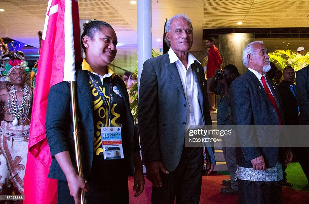 Tonga's Prime Minister Akilisi Pohiva (C) arrives for the official opening of the 46th Pacific Islands Forum (PIF) in Port Moresby on September 8, 2015. The 16-nation grouping consists mainly of small island nations, together with Australia and New Zealand, with the two developed nations being accused of dragging their feet on climate change. AFP PHOTO/Ness KERTON