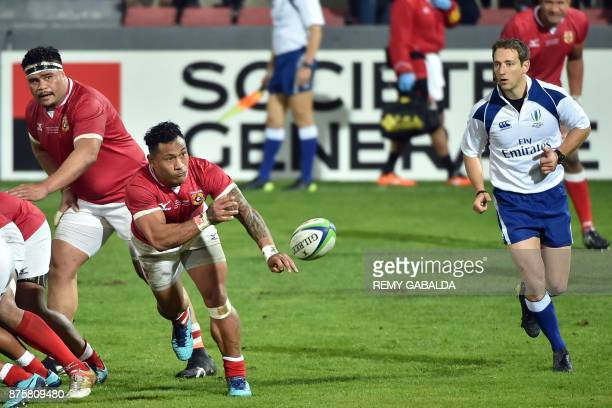 Tonga's scrumHalf Sonatane Takulua passes the ball during the test union international match between Japan and Tonga on November 18 at the Ernest...