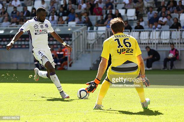Tongo Doumbia for Toulouse FC and Cedric Carrasso for FC Girondins de Bordeaux in action during the French Ligue 1 game between FC Girondins de...