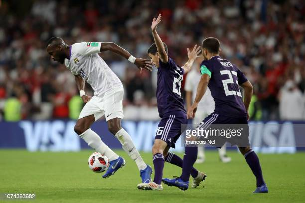 Tongo Doumbia of Al Ain is challenged by Ignacio Fernandez of River Plate during the FIFA Club World Cup UAE 2018 Semi Final Match between River...