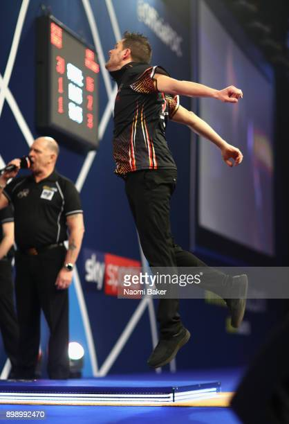 Toni Alcinas of Mallorca celebrates after winning the second round match against Kevin Munch of Germany on day eleven of the 2018 William Hill PDC...