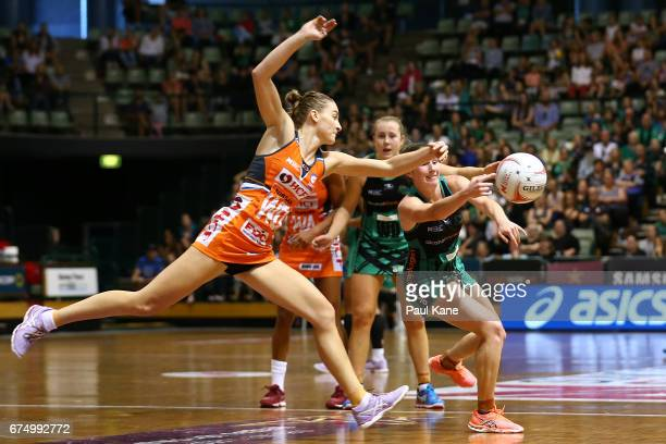 Toni Anderson of the Giants attempts to cut a pass off by Ingrid Colyer of the Fever during the round 10 Super Netball match between the Fever and...