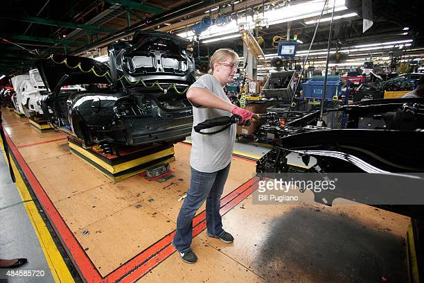 Toni Bales of Adrian Michigan works on a 2015 Ford Mustang as it goes through assembly at the Ford Flat Rock Assembly Plant August 20 2015 in Flat...