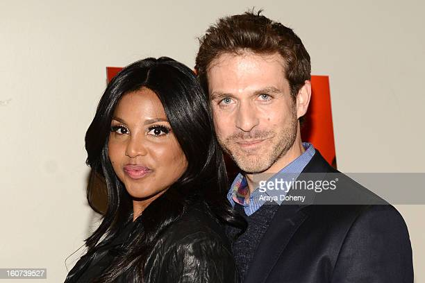 Toni Braxton and David Julian Hirsh arrive at the world premiere screening of Twist Of Faith at Stephen S Wise Temple on February 4 2013 in Los...