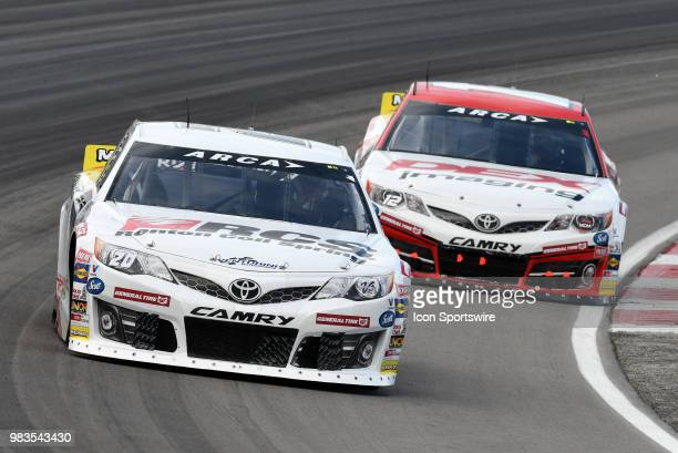 Toni Breidinger Venturini Motorsports Toyota Camry and Harrison Burton MDM Motorsports Toyota Camry work their way through turn four during the...