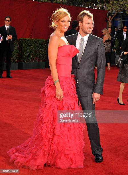 Toni Collette and Dave Galafassi arrive at the 61st Primetime Emmy Awards held at the Nokia Theatre on September 20 2009 in Los Angeles California