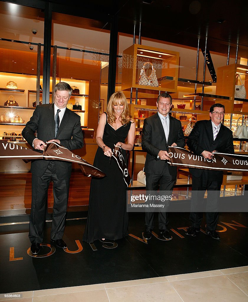 Toni Collette cuts the ribbon for the official opening of the new Louis Vuitton store at the Chadstone Shopping Centre along with Jean Baptiste Debains, Philip Corne and David Marcun on November 24, 2009 in Melbourne, Australia.