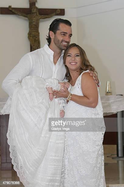 Toni Costa and Adamari Lopez pose with their baby Alaia on the baptism of Adamari Lopez's baby Alaia at La Sagrada Familia Catholic Church on June 30...
