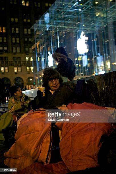 Toni DiGiorno of Pittsburgh cuddles with her granddaughter Giovanna Mullen of Montclair New Jersey as they wait on line for the release of Apple's...