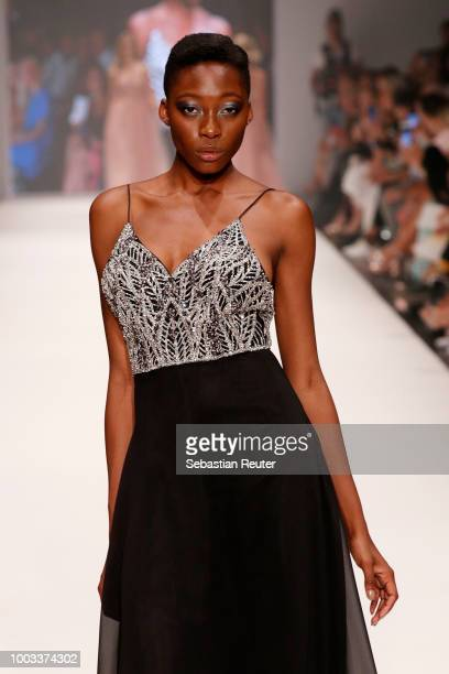 Toni DreherAdenuga walks the runway at the Unique by Lexus show during Platform Fashion July 2018 at Areal Boehler on July 21 2018 in Duesseldorf...