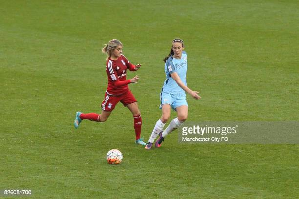 Toni Duggan and Andrine Hegerberg during the Women's Super League match at the Academy Stadium Manchester