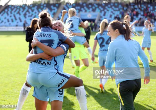 Toni Duggan and Nikita Parris of Manchester City celebrate winning The Women's Super League after beating Chelsea