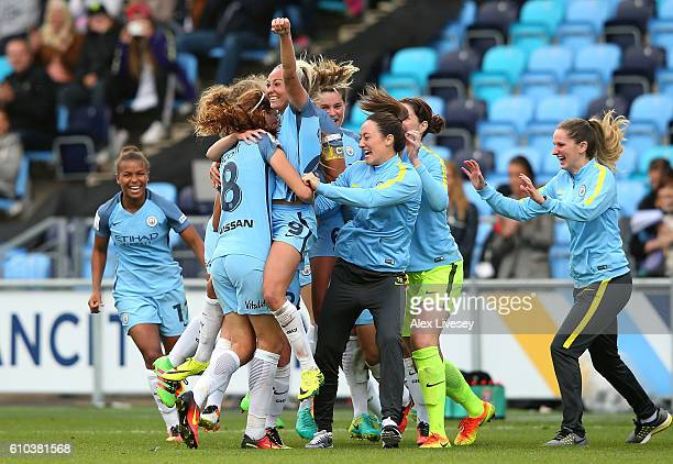 Toni Duggan and team mates of Manchester City Women celebrate as they win the WSL title after the FA Women's Super League match between Manchester...