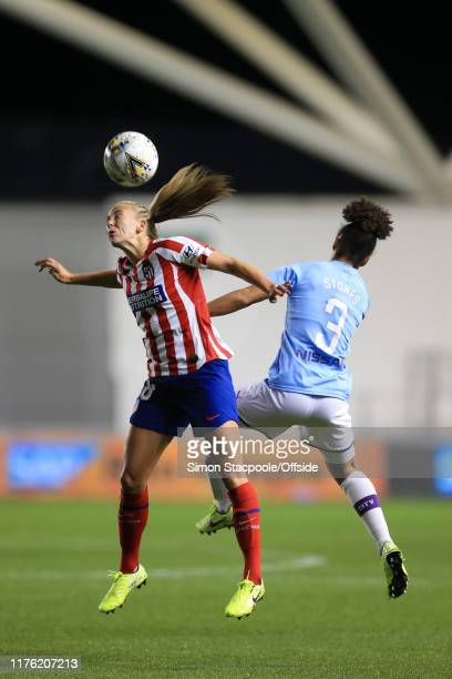 Toni Duggan of Atletico battles with Demi Stokes of Man City during the UEFA Women's Champions League Round of 16 First Leg match between Manchester...