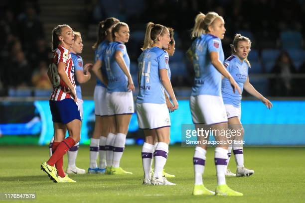 Toni Duggan of Atletico stands amongst her former teammates during the UEFA Women's Champions League Round of 16 First Leg match between Manchester...