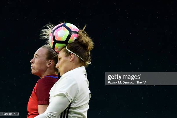 Toni Duggan of England and Babett Peter of Germany go after the ball in the second half during the 2017 SheBelieves Cup at RFK Stadium on March 7,...