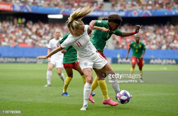 Toni Duggan of England battles for possession with Augustine Ejangue of Cameroon during the 2019 FIFA Women's World Cup France Round Of 16 match...