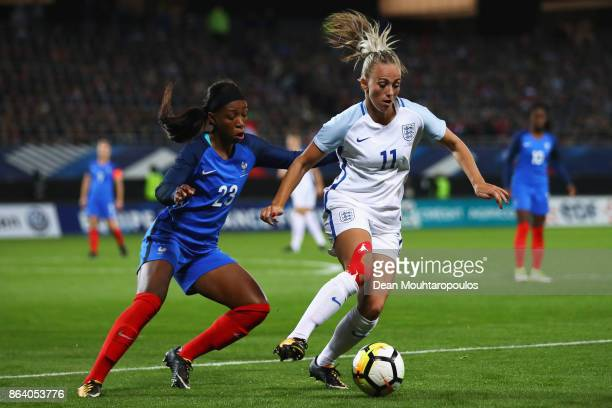 Toni Duggan of England battles for the ball with Onema Grace Geyoro of France during the International friendly match between France and England held...