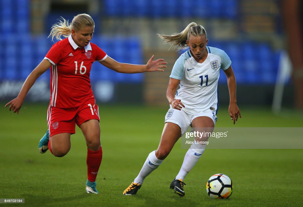 Toni Duggan of England beats Marina Fedorova of Russia during the FIFA Women's World Cup Qualifier between England and Russia at Prenton Park on September 19, 2017 in Birkenhead, England.