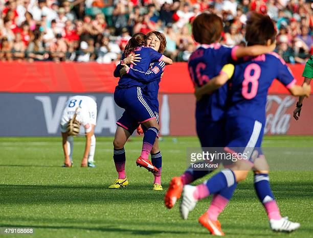 Toni Duggan of England bends over in rejection as Nahomi Kawasumi Mizuho Sakaguchi Mana Iwabuchi and Aya Miyama of Japan celebrate their win during...
