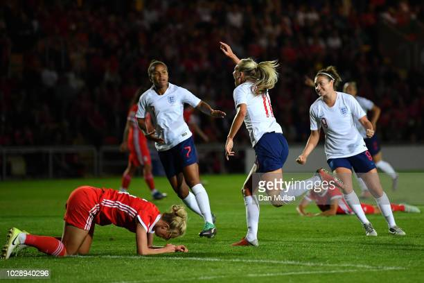 Toni Duggan of England celebrates scoring the first goal during the Women's World Cup qualifier between Wales Women and England Women at Rodney...