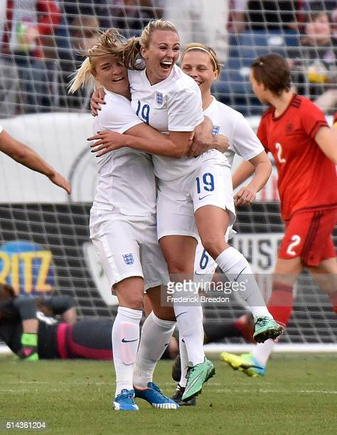 Toni Duggan of England celebrates with teammates after scoring a goal against Germany in a friendly international match of the Shebelieves Cup at...