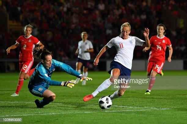 Toni Duggan of England goes around Laura O'Sullivan of Wales during the Women's World Cup qualifier between Wales Women and England Women at Rodney...