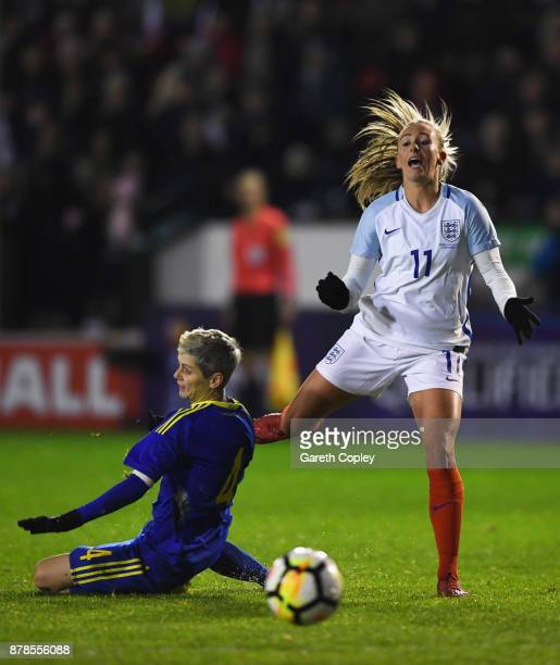 Toni Duggan of England is challenged by Amira Spahic of Bosnia and Herzegovina during the FIFA Women's World Cup Qualifier between England and Bosnia...