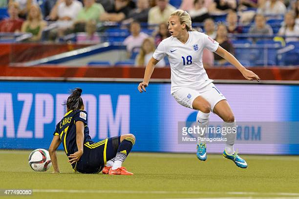 Toni Duggan of England looses the ball to Carolina Arias of Colombia during the 2015 FIFA Women's World Cup Group F match at Olympic Stadium on June...