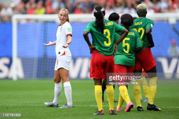 Toni Duggan of England talks to players of Cameroon during the 2019 FIFA Women's World Cup France Round Of 16 match between England and Cameroon at...