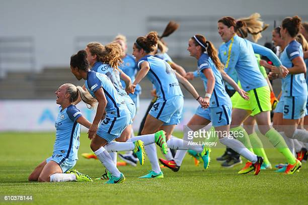 Toni Duggan of Manchester City Women and team mates celebrate as they win the WSL title after the WSL 1 match between Manchester City Women and...