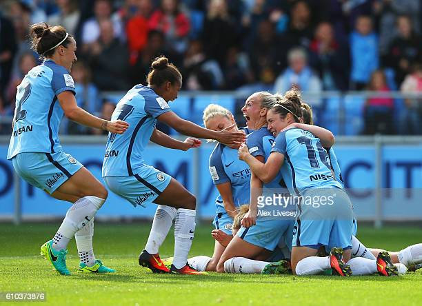 Toni Duggan of Manchester City Women celebrates with team mates as she scores their second goal from a penalty during the WSL 1 match between...