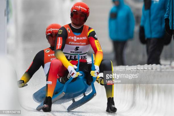 Toni Eggert and Sascha Benecken of Germany celebrate after the final run of the Luge World Championship double race at Veltins Eis-Arena on January...