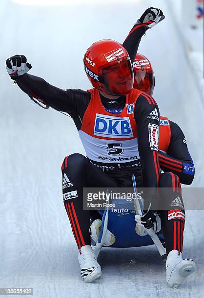 Toni Eggert and Sascha Benecken of Germany celebrate after winning the silver medal during the men's double run in the Luge World Championship on...