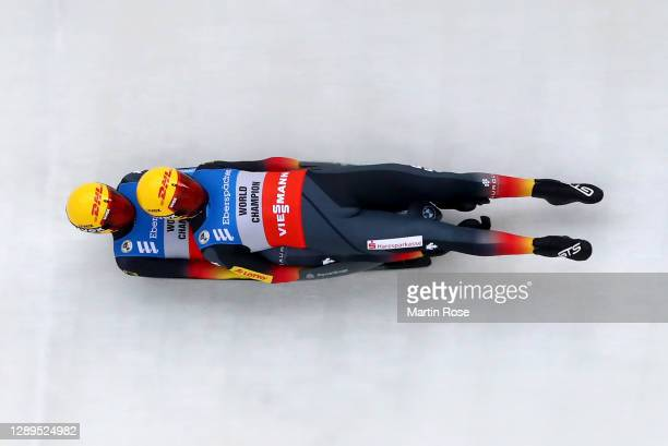 Toni Eggert competes with Sascha Benecken of Germany in the 1st run during the men's double during the FIL Luge World Cup at at ENSO-Eiskanal on...