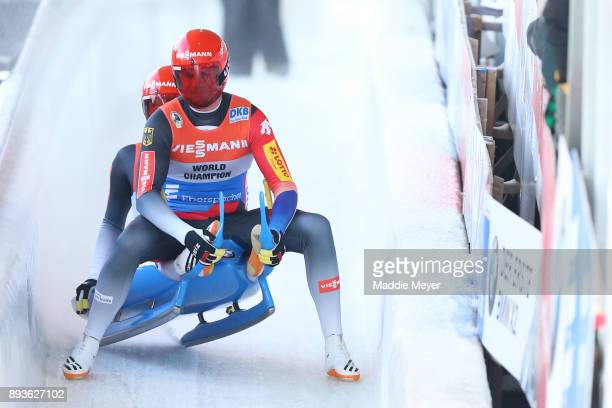 Toni Eggert front and Sascha Benecken of Germany finish in first place in the Doubles event in the Viessmann FIL Luge World Cup at Lake Placid...