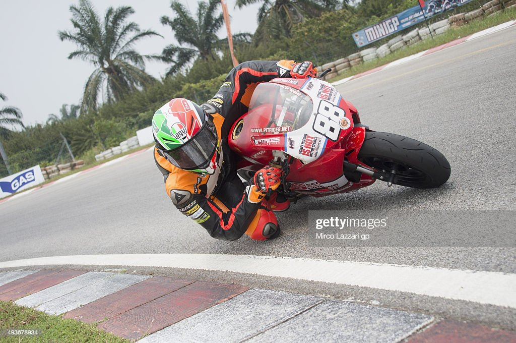 Toni Elias of Spain and Forward Racing rounds the bend during the pre-event 'Mini Bikes Race at the Sepang International Go-Kart Circuit' ahead of the MotoGP of Malaysia at Sepang Circuit on October 22, 2015 in Kuala Lumpur, Malaysia.