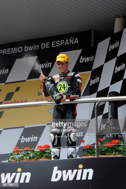 Toni Elias of Spain and Gresini Racing Moto2 celebrates and sprays champagne on the podium the victory at the end of the Moto2 race at Circuito de...