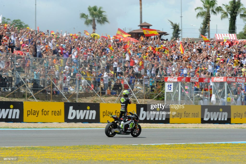 Toni Elias of Spain and Gresini Racing Moto2 celebrates in front his fans the victory at the end of the Moto2 race at Circuito de Jerez on May 2, 2010 in Jerez de la Frontera, Spain.