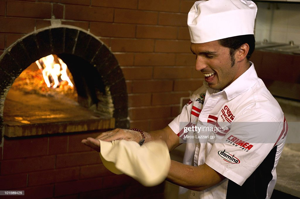 Toni Elias of Spain and Gresini Racing Moto2 prepares the Pizza in Pizzeria Il Rustico during the pre-event 'Riders learn how to make pizza' during the Grand Prix of Italy on June 3, 2010 in Mugello Circuit near Florence, Italy.