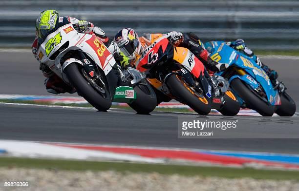 Toni Elias of Spain and San Carlo Honda Gresini leads Andrea Dovizioso of Italy and Repsol Honda Team and Loris Capirossi of Italy and Rizla Suzuki...