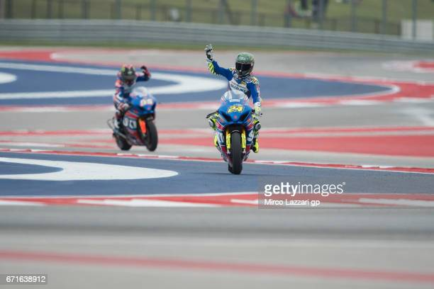 Toni Elias of Spain and Yoshumira Suzuki Factory Racing celebrates the victory in front of Roger Hayden of USA and Yoshumira Suzuki Factory Racing at...