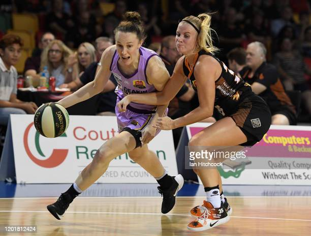 Toni Farnworth of the Boomers drives to the basket past Julie Vanloo of the Fire during the round 15 WNBL match between the Townsville Fire and the...