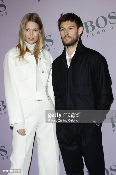 Toni Garrn and Alex Pettyfer attend the BOSS fashion show during the Milan Fashion Week Fall/Winter 2020 2021 on February 23 2020 in Milan Italy