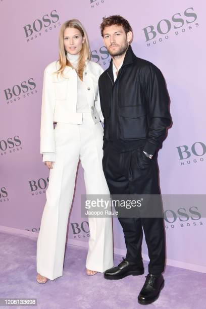 Toni Garrn and Alex Pettyfer attend the Boss fashion show on February 23 2020 in Milan Italy