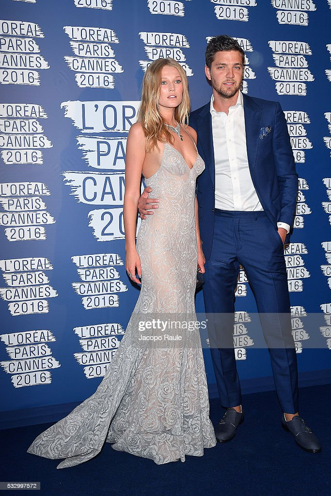 Toni Garrn and Chandler Parson attend the L'Oreal Paris Blue Obsession Party during the 69th annual Cannes Film Festival on May 18, 2016 in Cannes, France.